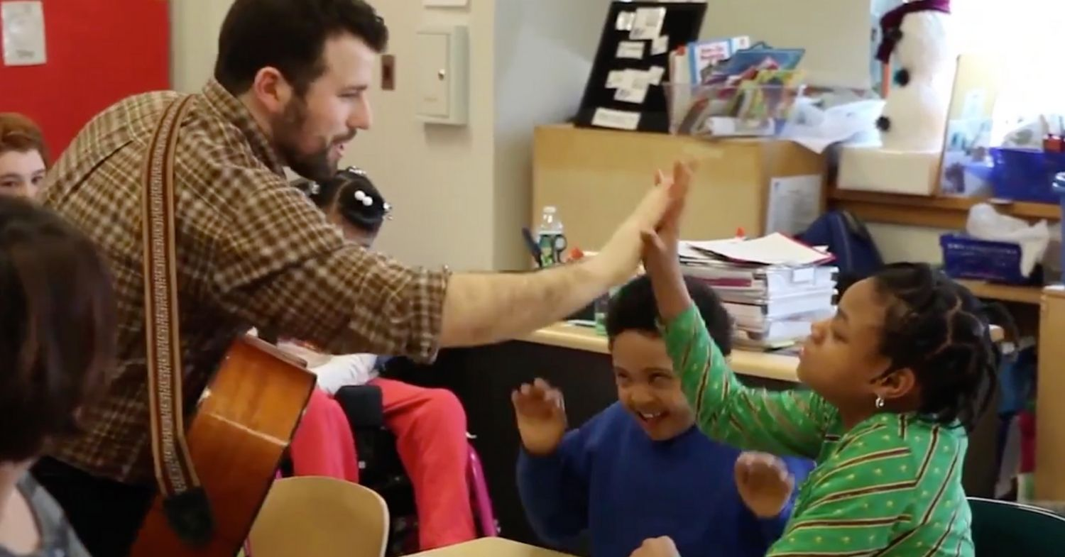 Literature at Play for Students with Disabilities - Teacher high-fiving student - NYC Children's Theater